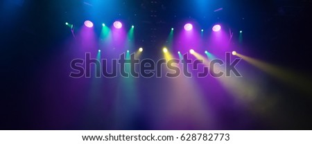 scene, stage light with colored spotlights and smoke #628782773
