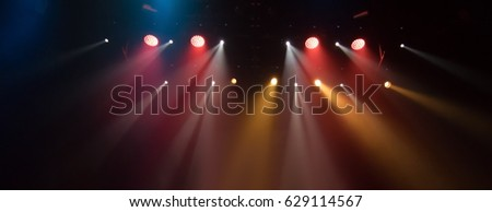 scene, stage light with colored spotlights and smoke #629114567