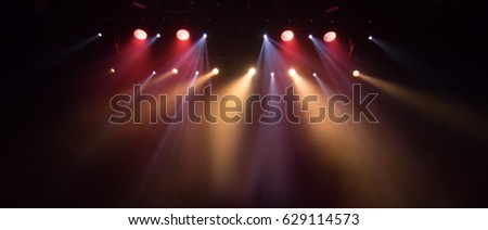 scene, stage light with colored spotlights and smoke #629114573