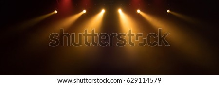 scene, stage light with colored spotlights and smoke #629114579