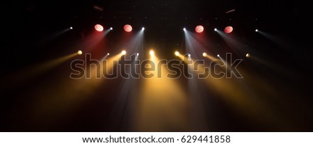 scene, stage light with colored spotlights and smoke #629441858