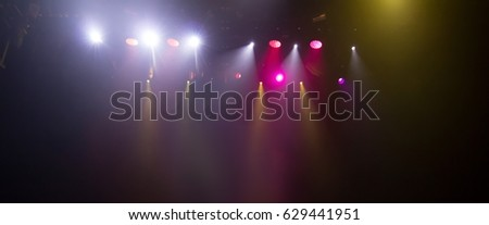 scene, stage light with colored spotlights and smoke #629441951
