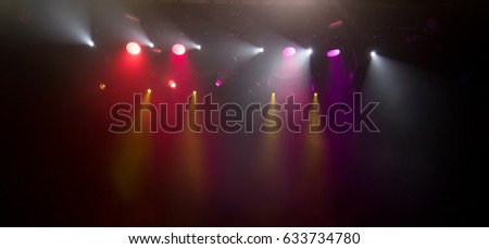 scene, stage light with colored spotlights and smoke #633734780