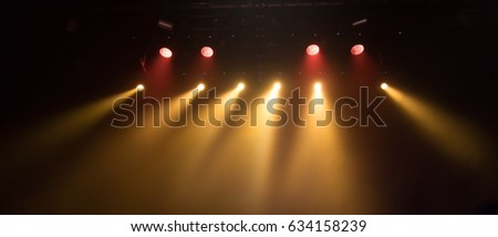 scene, stage light with colored spotlights and smoke #634158239