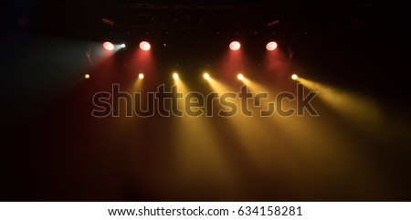 scene, stage light with colored spotlights and smoke #634158281