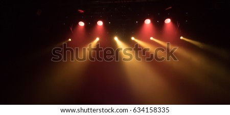 scene, stage light with colored spotlights and smoke #634158335