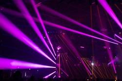 Scene, stage lights with colored spotlights and smoke, laser lights background, pink, purple, violet