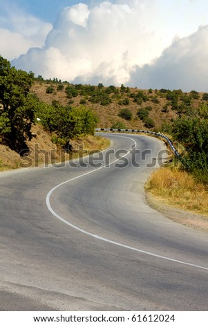 Scene with countryside asphalt road turn