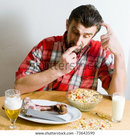 Scene with health, vegetarian food, smoked meat, glass of milk and beer. A man have a dilemma what take to eating