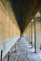 Scenery abstraction famous tunnel structure design of Angkor Wat with art historical on the wall, Siem Reap