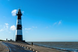Scenery at the seaside with lighthouse in Breskens, Netherlands