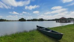 Scenery of beautiful cloud with canoe rests on a shore. Wetland Putrajaya Lake