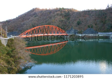 Scenery of bridge where orange color shines in wintry desolation #1171203895