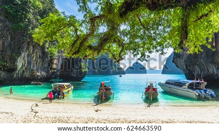 Scenery of destinations beach with speed boat and island, Lading island, Andaman sea, Krabi province, Thailand - Shutterstock ID 624663590