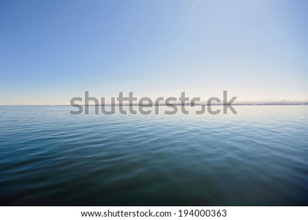 scenery of lake and horizon line on mountains