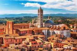 Scenery of Siena, a beautiful medieval town in Tuscany, with view of the Dome & Bell Tower of Siena Cathedral (Duomo di Siena), landmark Mangia Tower and Basilica of San Domenico,Italy