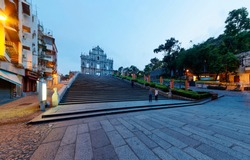 Scenery of the Ruins of St. Paul's Church in the Historic Center of Macau, China, with a paved promenade & a stairway leading to the beautiful facade of the historical architecture in morning twilight