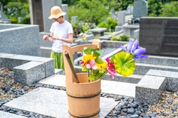 Scenery of visiting a Japanese grave