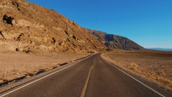 Scenery road through the amazing landscape of Death Valley National Park California - USA 2017