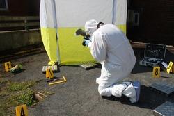 scenes of crime photographer CSI SOCO photographing crime scene, police crime scene