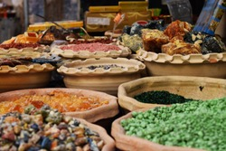 Scenes of food and home products such as candy and sweets, street food, spices and incense in markets in Tel Aviv and Jerusalem, Israel.
