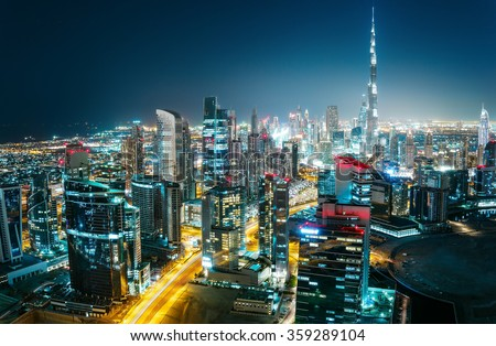 Scenic aerial cityscape at night with illuminated modern architecture. Downtown of Dubai, United Arab Emirates. #359289104