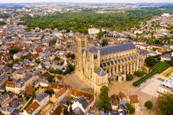 Scenic aerial view of Bourges town and surroundings in summer overlooking Gothic building of Roman Catholic Cathedral, France..