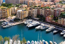 Scenic aerial view on luxury yachts and apartments of city centre and harbour of Monte Carlo, Cote d'Azur, Monaco, French Riviera.