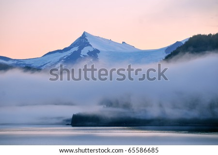 scenic alaska mountains and inside passage at dawn from cruise ship