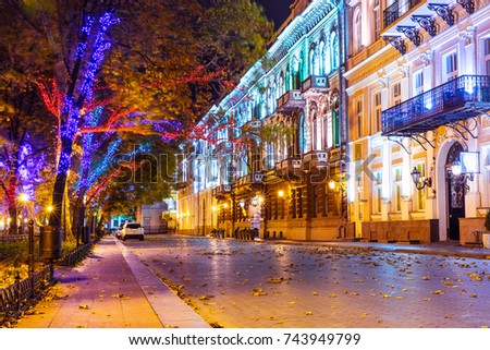 Scenic autumn night view of the Old Town illuminated architecture with a lot of color street lights at Primorsky Boulevard, Odessa, Ukraine #743949799