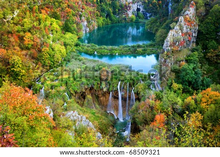 Scenic autumn valley landscape with lakes and waterfall in the mountains of Plitvice Lakes National Park, Croatia.