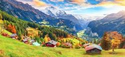 Scenic autumn view of picturesque alpine Wengen village and Lauterbrunnen Valley with Jungfrau Mountain and  on background. Location: Wengen village, Berner Oberland, Switzerland, Europe.
