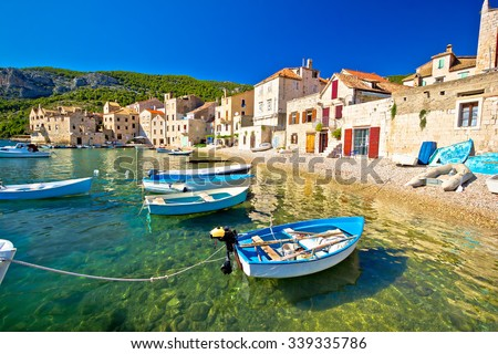 Scenic beach in Komiza village waterfront, Island of Vis, Croatia