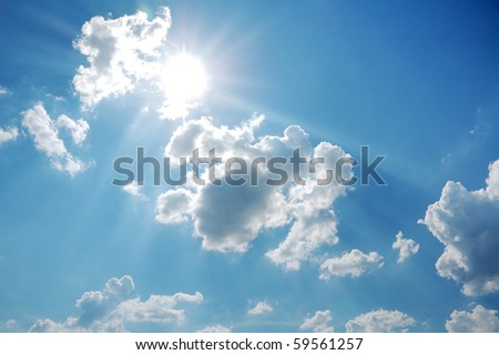 scenic blue sky with sun and clouds