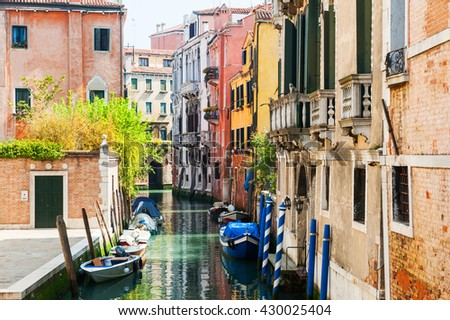Stock Photo Scenic canal with ancient buildings in Venice, Italy