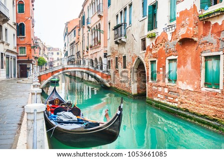 Scenic canal with bridge and gondola in Venice, Italy. #1053661085