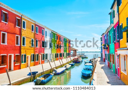 Scenic canal with colorful buildings in Burano island, Venice, Italy #1110484013