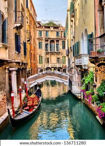 Scenic canal with gondola, Venice, Italy #136711280