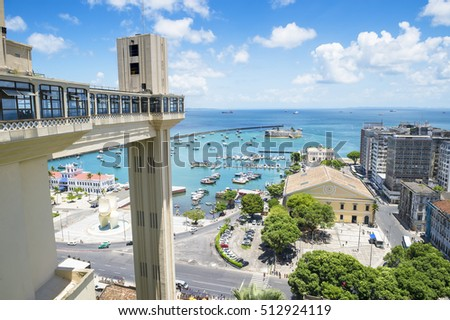 Scenic city skyline view of Salvador, Brazil with Lacerda Elevator, Bay of All Saints, and old Lower City architecture on the horizon