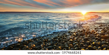 Scenic colorful sunset at the sea coast. Good for wallpaper or background image. Beautiful nature landscapes