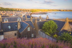 Scenic colourful townscape view of the quaint seaside fishing village of Cullen Bay and viaduct during summer in Moray Scotland.