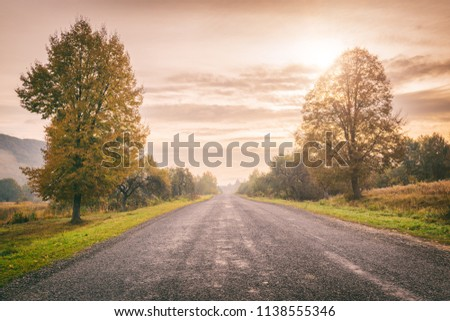 scenic country road at sunset...