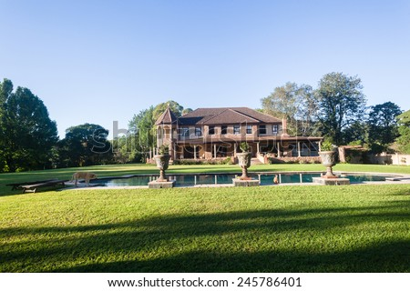 Scenic countryside home mansion home with open lawn trees swimming pool