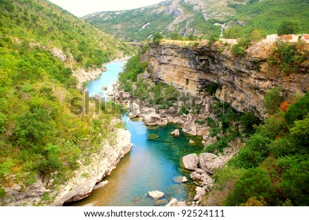 Scenic deep canyon with blue Tara river in Montenegro mountains #92524111