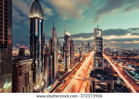 Scenic Dubai downtown architecture in the evening. Rooftop skyline with Sheikh Zayed road and many illuminated towers. #372373906