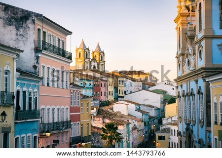 Scenic dusk view of a historic plaza surrounded by colonial buildings in the tourist district of Pelourinho, in Salvador, Bahia, Brazil