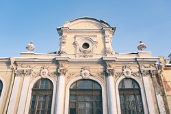 scenic facade of an ancient historic house in St. Petersburg Russia on the background of blue sky, historical exterior of the famous antique architecture building tourist landmark in the city tourism