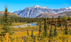 Scenic fall landscape with snow-capped mountains in Denali National Park, Alaska