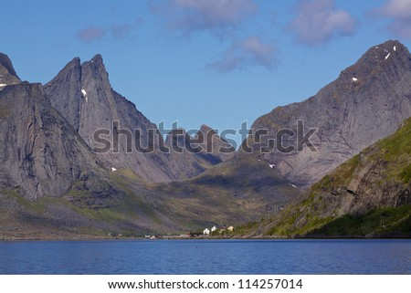Scenic fjord Reinefjorden on Lofoten islands in Norway, with high rocky mountain peaks towering above the sea