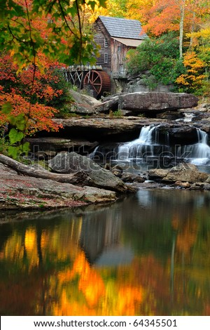 Scenic Glade Creek Grist Mill in West Virginia with fall colors in orange and red